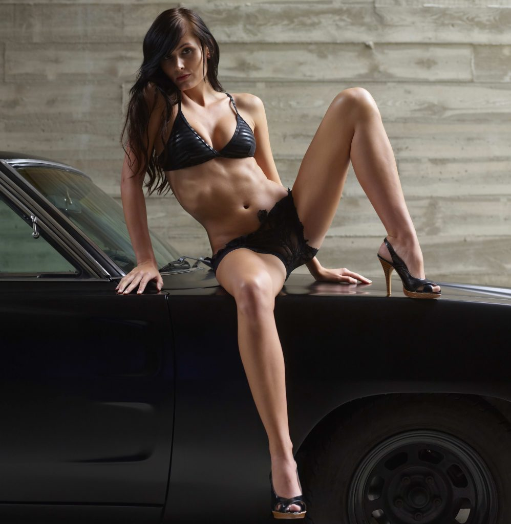 Sexy Brunette On A Car Hood